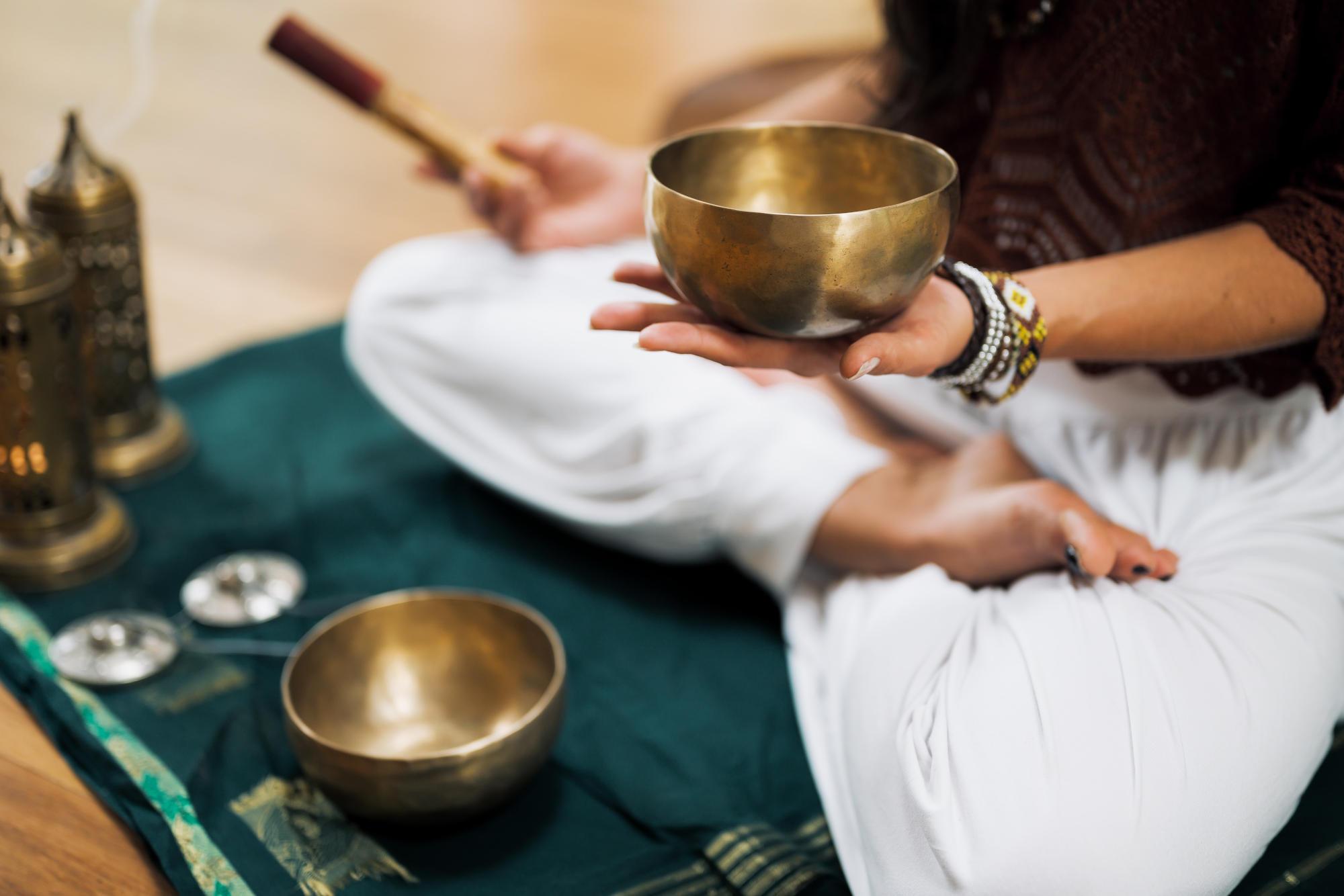 Woman with meditating bowl