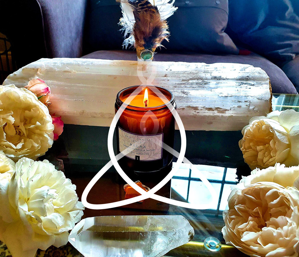 Candle and flowers on coffee table
